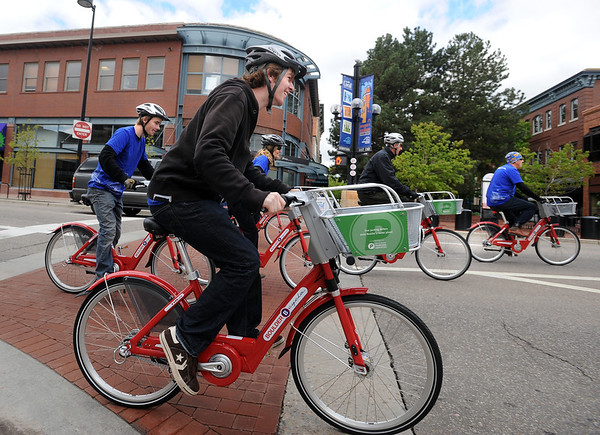 """John Hazlitt, center, is a volunteer going for a ride with his group.<br /> Boulder B-cycle is a community nonprofit formed to implement and operate a bike-share system in the City of Boulder. <br /> For more photos and a video of B-cycles opening day, go to  <a href=""""http://www.dailycamera.com"""">http://www.dailycamera.com</a>.<br /> Cliff Grassmick/ May 20, 2011"""