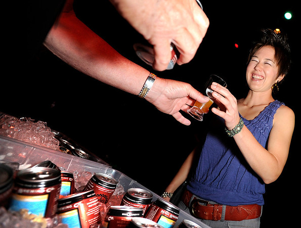 "Candace Choy, of Boulder, right, gets a sample of beer from Ernie Bjorkman during the Boulder Brew and Music Festival on Saturday, Nov. 5, at the Fox Theatre in Boulder. For more photos and a video of the festival go to  <a href=""http://www.dailycamera.com"">http://www.dailycamera.com</a><br /> Jeremy Papasso/ Camera"