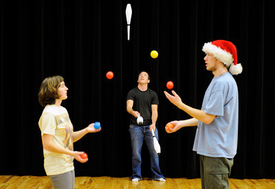 Jill DeBiase, of Boulder, left, and Connor Rideout, of Boulder, right, practice two-person juggling while Aiden London, of Fort Collins, center juggles some pins on Sunday, Dec. 18, at the Boulder Circus Center on N. 26th Avenue in Boulder. For more photos of the Circus Center go to www.dailycamera.com Jeremy Papasso/ Camera