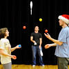 "Jill DeBiase, of Boulder, left, and Connor Rideout, of Boulder, right, practice two-person juggling while Aiden London, of Fort Collins, center juggles some pins on Sunday, Dec. 18, at the Boulder Circus Center on N. 26th Avenue in Boulder. For more photos of the Circus Center go to  <a href=""http://www.dailycamera.com"">http://www.dailycamera.com</a><br /> Jeremy Papasso/ Camera"