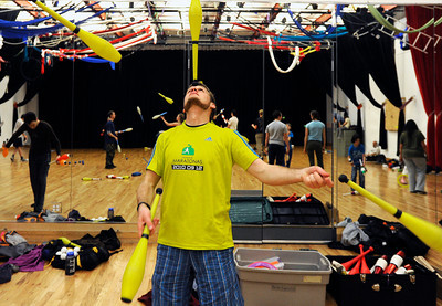 Jeff Lutkus, of Boulder, juggles three bowling pins while balancing one on his forehead on Sunday, Dec. 18, at the Boulder Circus Center on N. 26th Avenue in Boulder. For more photos of the Circus Center go to www.dailycamera.com Jeremy Papasso/ Camera