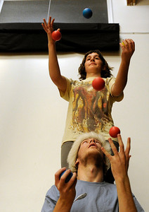 Jill DeBiase, of Boulder, top, and Connor Rideout, of Boulder, practice two-person juggling on Sunday, Dec. 18, at the Boulder Circus Center on N. 26th Avenue in Boulder. For more photos of the Circus Center go to www.dailycamera.com Jeremy Papasso/ Camera