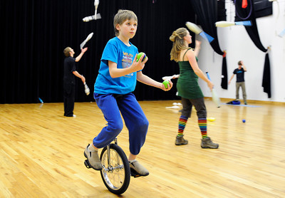 Curtis Peterson, rides a unicycle while he tries to juggle on Sunday, Dec. 18, at the Boulder Circus Center on N. 26th Avenue in Boulder. For more photos of the Circus Center go to www.dailycamera.com Jeremy Papasso/ Camera