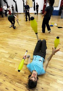 Bekah Smith, of Boulder, practices juggling while laying on her back on Sunday, Dec. 18, at the Boulder Circus Center on N. 26th Avenue in Boulder. For more photos of the Circus Center go to www.dailycamera.com Jeremy Papasso/ Camera