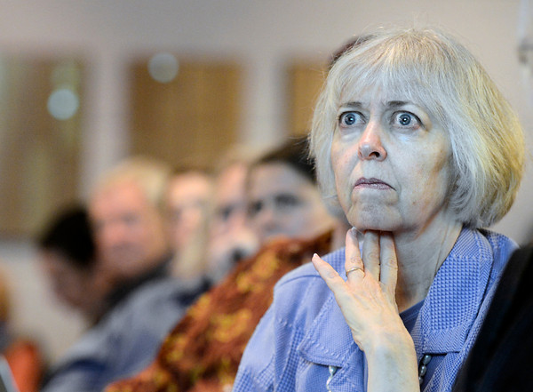 "Tricia Olson, of Gunbarrell, listens to the debate on the fracking moratorium during a Boulder County Commissioners meeting on Thursday, Jan. 24, at the Boulder County Courthouse on Pearl Street in Boulder. For a video with an anti-fracking supporter go to  <a href=""http://www.dailycamera.com"">http://www.dailycamera.com</a><br /> Jeremy Papasso/ Camera"