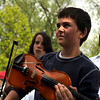 """Sam Rosenbaum, 11, of Boulder, center, waits his turn to play his violin on stage on Saturday, May 28, during the Boulder Creek Festival in Boulder. For more photos of the festival go to  <a href=""""http://www.dailycamera.com"""">http://www.dailycamera.com</a><br /> Jeremy Papasso/ Camera"""