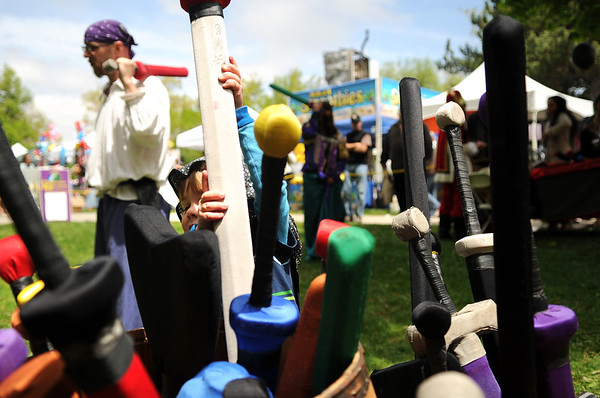 "Kieran Schmidt, 3, of Louisville, pulls another sword out of the basket while sword fight playing on Saturday, May 28, during the Boulder Creek Festival in Boulder. For more photos of the festival go to  <a href=""http://www.dailycamera.com"">http://www.dailycamera.com</a><br /> Jeremy Papasso/ Camera"