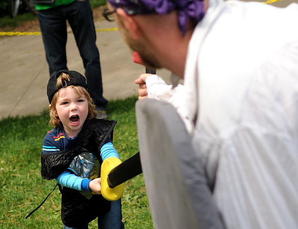 "Kieran Schmidt, 3, of Louisville, sword fights with John Scheuerman, of Boulder, on Saturday, May 28, during the Boulder Creek Festival in Boulder. For more photos of the festival go to  <a href=""http://www.dailycamera.com"">http://www.dailycamera.com</a><br /> Jeremy Papasso/ Camera"