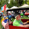 """Vern DeGroot, of Littleton, drives the mini train in circles for the kids on Saturday, May 28, during the Boulder Creek Festival in Boulder. For more photos of the festival go to  <a href=""""http://www.dailycamera.com"""">http://www.dailycamera.com</a><br /> Jeremy Papasso/ Camera"""