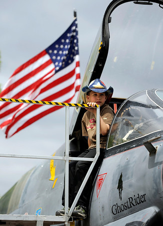 "Max Larson, 8, of Westminster, sits on the cockpit of a A-7D Corsair II aircraft on Saturday, May 28, during the Boulder Creek Festival in Boulder. For more photos of the festival go to  <a href=""http://www.dailycamera.com"">http://www.dailycamera.com</a><br /> Jeremy Papasso/ Camera"