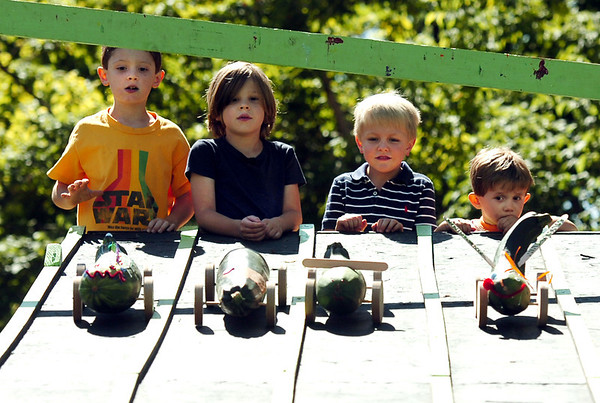 "Keaton Jarvis, 7, at left, Rowan Risner, 6, Ian Soderberg, 5, and Joe Danforth, 3, watch their zucchini-mobiles during a zucchini race on Saturday, Sept. 3, during the Boulder Creek Hometown Fair in Boulder. For more photos and video of the fair go to  <a href=""http://www.dailycamera.com"">http://www.dailycamera.com</a><br /> Jeremy Papasso/ Camera"