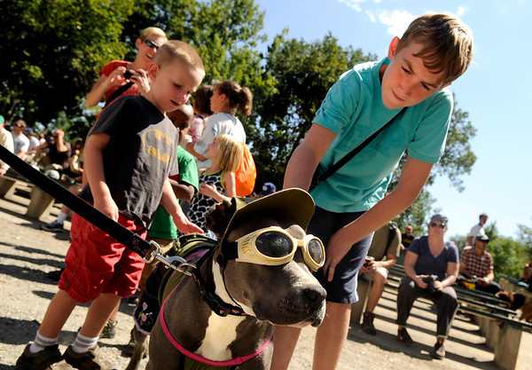 "Jake Belanger, 12, of Littleton, pets Candy, the dog, on Saturday, Sept. 3, during the Boulder Creek Hometown Fair in Boulder. For more photos and video of the fair go to  <a href=""http://www.dailycamera.com"">http://www.dailycamera.com</a><br /> Jeremy Papasso/ Camera"