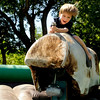 "Boden Foreman-Hansen, 3, of Boulder, rides a mechanical bull on Saturday, Sept. 3, during the Boulder Creek Hometown Fair in Boulder. For more photos and video of the fair go to  <a href=""http://www.dailycamera.com"">http://www.dailycamera.com</a><br /> Jeremy Papasso/ Camera"