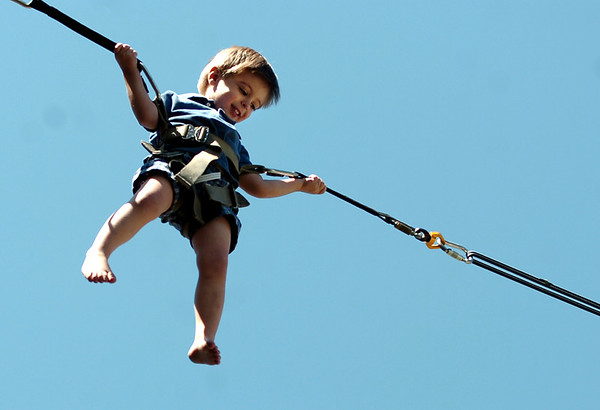 "Noah Orme, 3, of Dallas, smiles as he jumps on a trampoline device on Saturday, Sept. 3, during the Boulder Creek Hometown Fair in Boulder. For more photos and video of the fair go to  <a href=""http://www.dailycamera.com"">http://www.dailycamera.com</a><br /> Jeremy Papasso/ Camera"