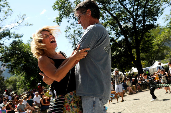 "Dawn Beck, at left, dances with her boyfriend Gerard Gatz, both of Boulder, on Saturday, Sept. 3, during the Boulder Creek Hometown Fair in Boulder. For more photos and video of the fair go to  <a href=""http://www.dailycamera.com"">http://www.dailycamera.com</a><br /> Jeremy Papasso/ Camera"