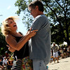 """Dawn Beck, at left, dances with her boyfriend Gerard Gatz, both of Boulder, on Saturday, Sept. 3, during the Boulder Creek Hometown Fair in Boulder. For more photos and video of the fair go to  <a href=""""http://www.dailycamera.com"""">http://www.dailycamera.com</a><br /> Jeremy Papasso/ Camera"""
