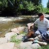 "Alan and Travis Taylor, relax by Boulder Creek in Eben Fine Park.<br /> There were several visitors to Boulder Creek and Eben Fine Park on June 8, 2011, but few actually got in the water.<br /> For a video and more photos of the creek, go to  <a href=""http://www.dailycamera.com"">http://www.dailycamera.com</a>.<br /> Cliff Grassmick / June 8, 2011"