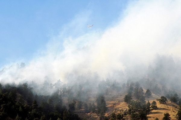 A slurry bomber flies over the Dome Fire west of Boulder on Friday, Oct. 29, 2010.<br /> Cameron Redwine/ Camera
