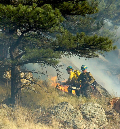 Firefighters work the ridgeline above Boulder Canyon as trees catch fire near Boulder in the Dome Fire on Friday morning October 29, 2010.<br /> Photo by Paul Aiken / The Camera