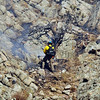 A firefigher works on a rocky slope in Boulder Canyon west of Boulder on Friday, Oct. 29, 2010.<br /> Cameron Redwine/ Camera
