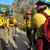 Firefighters plan their attack as they stage near Boulder in Boulder Canyon as the work the Dome Fire on Friday morning October 29, 2010.<br /> Photo by Paul Aiken / The Camera