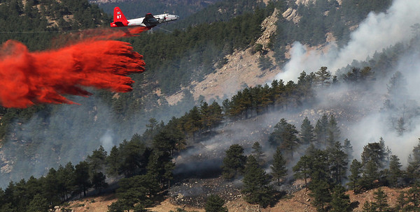 A slurry bomber drops a load of fire retardant on the Dome Fire in Boulder Colorado on Friday afternoon October 29, 2010.<br /> Photo by Sam Hall / The Camera