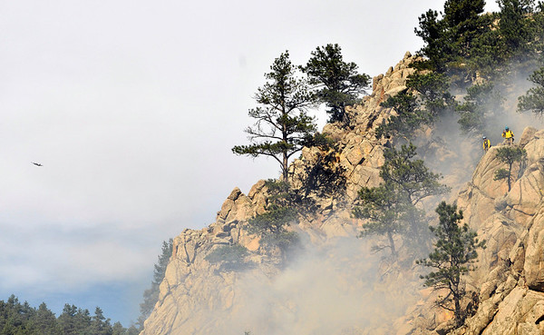 Firefighers work on a rocky cliff west of Boulder on Friday, Oct. 29, 2010.<br /> Cameron Redwine/ Camera