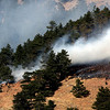 Firefighters work to contain the Dome Fire in Boulder Colorado on Friday afternoon October 29, 2010.<br /> Photo by SAM HALL / The Camera