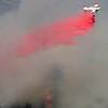 A slurry bomber drops fire retardant on the Dome Fire. Photo by Sam Hall