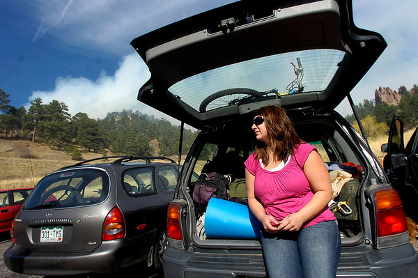 Seanna Biggs waits with a packed car while the Dome Fire Burns in the parking lot of her home on the 100 Block of Pearl Street on Friday morning.<br /> Photo by Paul Aiken / The Camera
