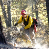 Firefighter Russell Brave of Rosebud South Dakota finishes cleaning up brush after his crew cut down a tree as crews continue working on cleaning up the Dome Fire in Boulder Colorado on Saturday October 30, 2010. <br /> Photo by Paul Aiken / The Camera