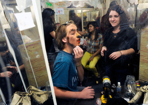 Boulder High School sophomore Will Hunsaker fixes smears the fake blood on his chin while senior Talia Kracauer watches on Thursday, Oct. 18, at the Boulder High School Haunted House.<br />  Jeremy Papasso/ Camera