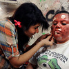 Boulder High School sophomore Pritika Mahat, left, applies makeup to sophomore Jessica Osorio on Thursday, Oct. 18, at the Boulder High School Haunted House.<br />  Jeremy Papasso/ Camera