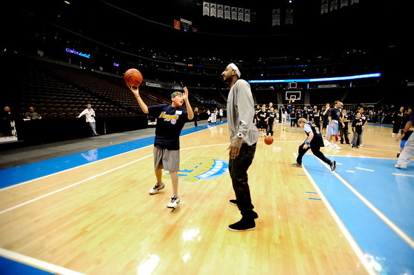 Boulder High's Francisco Longoria (left) takes a skyhook shot over Denver Nuggets Renaldo Balkman (right) during a Special Olympics Basketball Clinic held at the Pepsi Center in Denver, Colorado February 23, 2010.  CAMERA/Mark Leffingwell