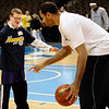 Boulder High's Matthew Salance (left) tries to get the ball from Denver Nuggets Malik Allen (right) during a Special Olympics Basketball Clinic held at the Pepsi Center in Denver, Colorado February 23, 2010.  CAMERA/Mark Leffingwell