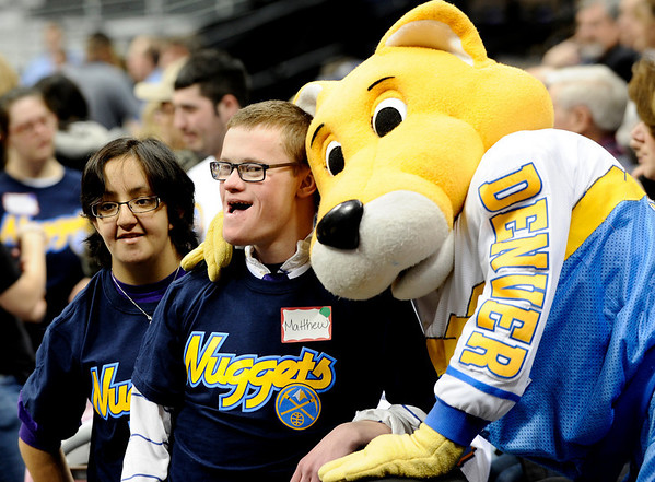 Boulder High's Matthew Salance (middle) and Monica Barrios (left) pose with Denver Nuggets mascott Rocky (right) during a Special Olympics Basketball Clinic held at the Pepsi Center in Denver, Colorado February 23, 2010.  CAMERA/Mark Leffingwell