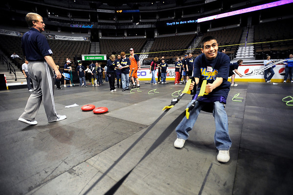 Boulder High's Hector Almeda Rodriguez follows one of the Denver Nuggets exercises during a Special Olympics Basketball Clinic held at the Pepsi Center in Denver, Colorado February 23, 2010.  CAMERA/Mark Leffingwell