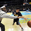 Boulder High's Jose Roman (right) steals the ball from Denver Nuggets Renaldo Balkman (left) during a Special Olympics Basketball Clinic held at the Pepsi Center in Denver, Colorado February 23, 2010.  CAMERA/Mark Leffingwell