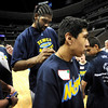 Boulder High's Roman (right) get his t-shirt signed by Denver Nuggets Nene (left)  during a Special Olympics Basketball Clinic held at the Pepsi Center in Denver, Colorado February 23, 2010.  CAMERA/Mark Leffingwell