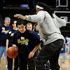 Boulder High's Jonathon Thao (left) tries to get the ball past Denver Nuggets Renaldo Balkman (right) during a Special Olympics Basketball Clinic held at the Pepsi Center in Denver, Colorado February 23, 2010.  CAMERA/Mark Leffingwell t