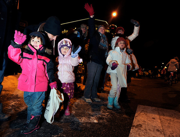 """Portia Richards, 4, and Mazzy Srom, 4, wave to Santa as he passes by them on Saturday, Dec. 3, during the Holiday Lights Parade in downtown Boulder. For more photos and video of the parade go to  <a href=""""http://www.dailycamera.com"""">http://www.dailycamera.com</a><br /> Photo by Jeremy Papasso"""