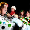 "Lucie Uhr, left, Ella Larson, Monica Rotner, and Minna Uhr laugh while they get their Christmas present costumes ready for the Holiday Lights Parade on Saturday, Dec. 3, in downtown Boulder. For more photos and video of the parade go to  <a href=""http://www.dailycamera.com"">http://www.dailycamera.com</a><br /> Photo by Jeremy Papasso"