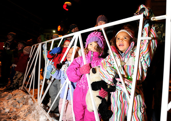 """Nailah McGhee, 5, right, and Echo Siglin, 5, middle, look in amazement as Santa passes by them on Saturday, Dec. 3, during the Holiday Lights Parade in downtown Boulder. For more photos and video of the parade go to  <a href=""""http://www.dailycamera.com"""">http://www.dailycamera.com</a><br /> Photo by Jeremy Papasso"""