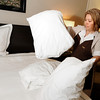 Best Western Plus employee Olga Macias makes a bed after a customer checked out on Thursday, May 3, in Boulder.<br /> Jeremy Papasso/ Boulder Daily Camera