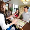 Best Western Plus employee Ashley Lander, left, points out key locations on a map for Catie Knowlton and her boyfirend Adam VahHorn, both of Colorado Springs, on Thursday, May 3, in Boulder. Knowlton and VanHorn were in town sightseeing.<br /> Jeremy Papasso/ Boulder Daily Camera