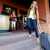 Kristin Larson, of Denver, walks toward her car after checking out of the Hotel Boulderado on Thursday, May 3, in Boulder.<br /> Jeremy Papasso/ Boulder Daily Camera