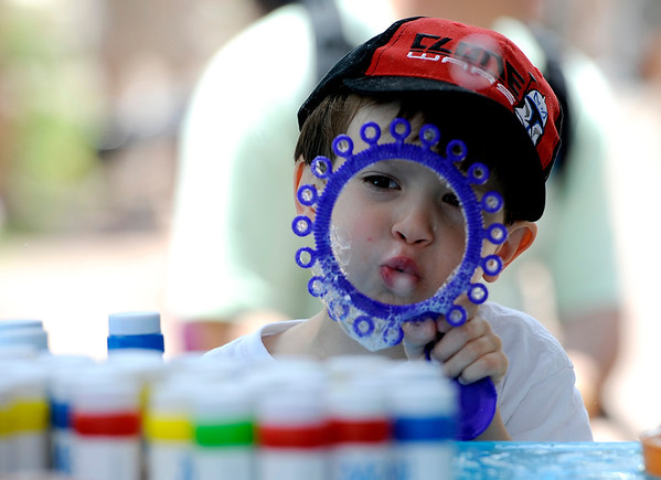 """Angelo Bass, 5, blows bubbles at the Mazel Tot booth during the Jewish Festival on the Pearl Street Mall in Boulder, Colorado June 12, 2011.  CAMERA/Mark Leffingwell<br /> <br /> Watch video from the Jewish Festival at  <a href=""""http://www.dailycamera.com"""">http://www.dailycamera.com</a>"""