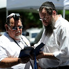 "Rabbi Pesach Scheiner (right) and Richard Stein (left) perform a daily prayer during the Jewish Festival on the Pearl Street Mall in Boulder, Colorado June 12, 2011.  CAMERA/Mark Leffingwell<br /> <br /> Watch video from the Jewish Festival at  <a href=""http://www.dailycamera.com"">http://www.dailycamera.com</a>"