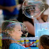 "Adenet Goldfeder, 6, dodges a large bubble she made while playing at the Mazel Tot booth during the Jewish Festival on the Pearl Street Mall in Boulder, Colorado June 12, 2011.  CAMERA/Mark Leffingwell<br /> <br /> Watch video from the Jewish Festival at  <a href=""http://www.dailycamera.com"">http://www.dailycamera.com</a>"