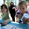 "Leah Ratzlaff (right), 9, and Sarah Rittenhouse (left), 6, work on Tzedakah boxes during the Jewish Festival on the Pearl Street Mall in Boulder, Colorado June 12, 2011.  CAMERA/Mark Leffingwell<br /> <br /> Watch video from the Jewish Festival at  <a href=""http://www.dailycamera.com"">http://www.dailycamera.com</a>"